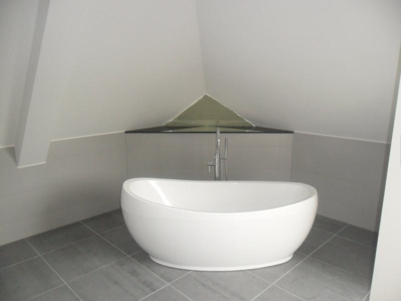 exclusief tegel- en stukadoorswerk badkamer
